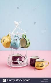 creative mugs creative cute coffee mugs on blue pink background stock photo