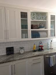 white shaker cabinets with glass doors open shelves plate rack