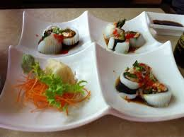planet cuisine tiger salmon stuffed into calamari with eel sauce one of