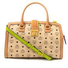 mcm designer mcm beige monogram bag orange green details your go to shopping