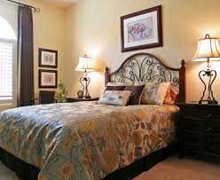 interesting perfect guest room with wrought iron headboard also