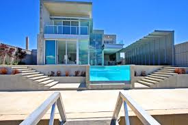 marvelous architecture beach house design with blue glass swimming