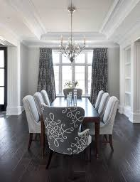 White Wooden Dining Room Chairs by Gray Dining Room Features A Tray Ceiling Accented With A Satin