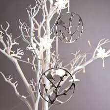 silver bird on branch ornament by uniquely eclectic
