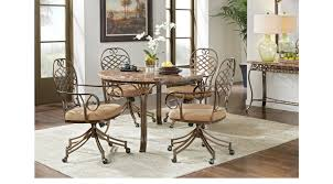 alegra metal 5 pc round dining set with stone top swivel chair