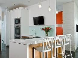 White Kitchen Pendant Lights by Glass Tile Backsplash Stainless Steel Appliance Quartz Countertop