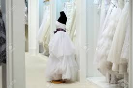the range of wedding dresses on hangers and on a mannequin in