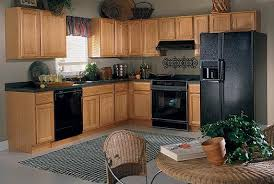 best color kitchen cabinets with black appliances oak kraftmaid cabinet jpg 525 352 black appliances