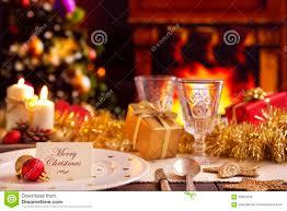 christmas table with fireplace and christmas tree stock photo