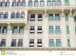 colorful british colonial style windows from singapore stock photo