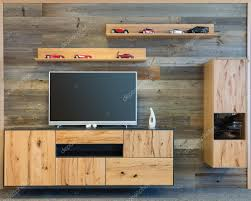 designer living room wall with tv wooden cupboard and shelf