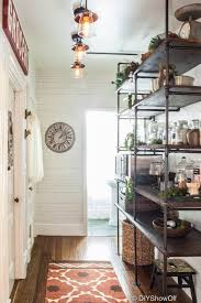 ten pantries with farmhouse style pantry open shelving and pipe metal kitchen shelves diy ideas for a rustic industrial farmhouse pantry more