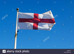 The England Flag The England Flag Flying Against A Blue Sky On A Summers Day Stock