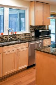 what color granite goes with brown cabinets 50 popular brown granite kitchen countertops design ideas
