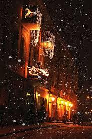 time snowfall city lights winter snow buildings