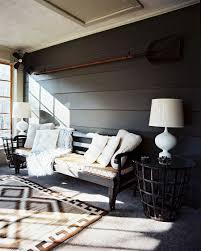 designs ideas dark living room with black armchair also unique