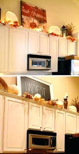 top of kitchen cabinet decorating ideas above kitchen cabinet decorative accents decor on top of cabinets