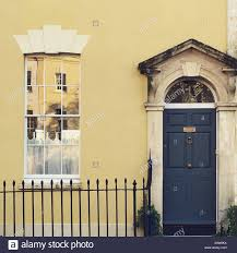 painted yellow house with dark blue front door in bristol stock