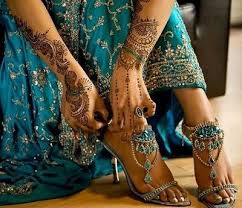 henna and teal blue indian wedding dress and heels the dress is