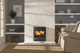 Gray Fireplace Placed On The White Wall Plus Floating White Wooden