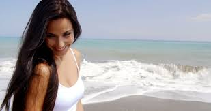 attractive middle aged women dark hair attractive woman with long dark hair smiling coyly over shoulder