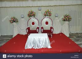 marriage reception hall decorations with chairs stock photo