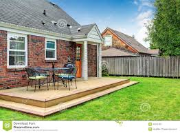 Wooden Patio Decks brick house exterior with walkout wooden deck stock photo image
