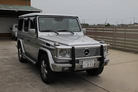 mercedes benz g55l amg with books and keys at