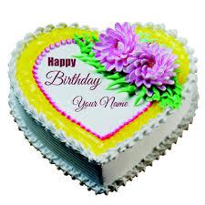 write name on heart shape butterscotch white cake