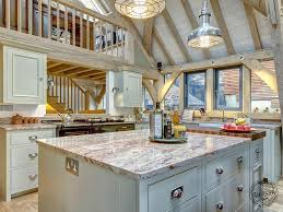 timber frame design and timber frame additions kitchen breakfast island and mezzanine gallery in oak framed extension on house in dartmouth