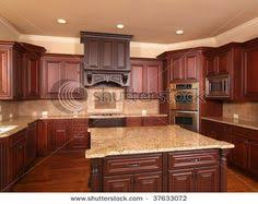 cherry kitchen ideas cherry kitchen cabinets with gray wall and quartz countertops ideas