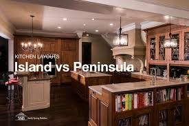 peninsula island kitchen when to choose a peninsula an island in your kitchen
