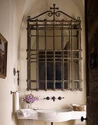 repurposed ornamental iron mirrors