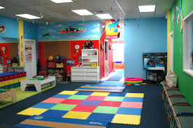 colorful playroom rugs for your kids with hanging toys also