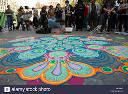 colored sand joe mangrum creates a painting using colored sand in union square