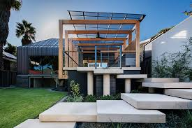 modern pergola this house extension has a modern pergola that leads to a swimming