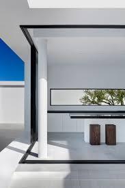 minimalist greek villa with dramatic ocean and island view