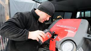 changing the oil in our portable generator honda eu3000i handi