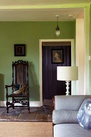 scheme 18 a living room with walls painted in calke green now