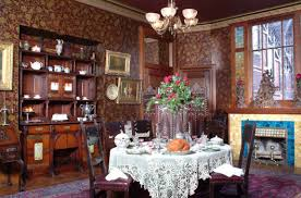victorian style dining room with wallpaper and fireplace annd