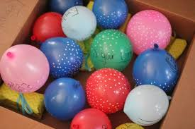 balloons in a box our in a click pinned birthday in a box
