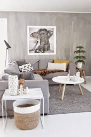 scandinavian living room gray couch white tables neutral