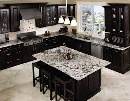 country kitchen with compact white island also black appliance and