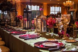 glamorous fall wedding centerpieces metallic lanterns green linens