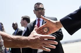 During Challenge Obama In Photos Handing Servicemen Challenge Coins During