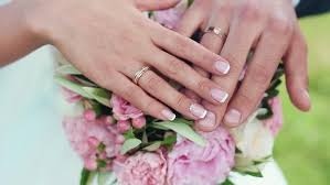 wedding rings on newly wed s with wedding rings and groom with