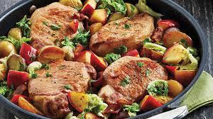 comment cuisiner des cotes de porc côtelettes de porc à la pomme et au chou recettes iga ail