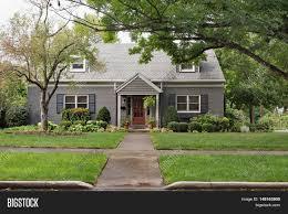 gray brick cape cod house on image u0026 photo bigstock