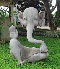 intriguing abstract design cement statue of ganesh in the garden