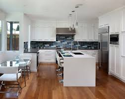 contemporary kitchen with flat panel cabinets by urban west